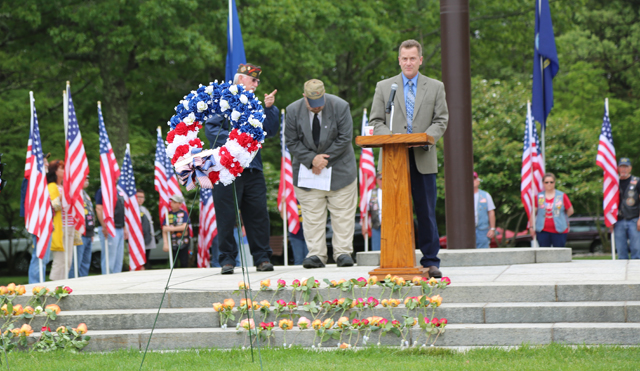 Riverhead Town Supervisor Sean Walter addresses the crowd at Calverton National Cemetery Monday. (Credit: Grant Parpan)
