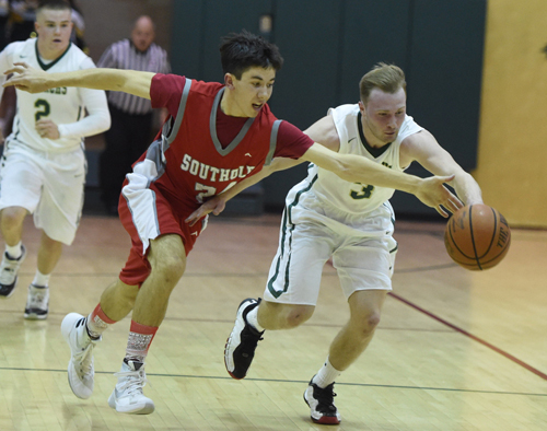 Southold's Pat McFarland and Bishop McGann-Mercy's Joe Jeskie chase after a loose ball during Thursday night's non-league game. (Credit: Robert O'Rourk)