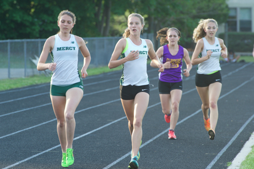 Bishop McGann-Mercy's Kaitlyn Butterfield, far left, and Meg Tuthill led the way during the 1,500-meter race. (Credit: Robert O'Rourk)