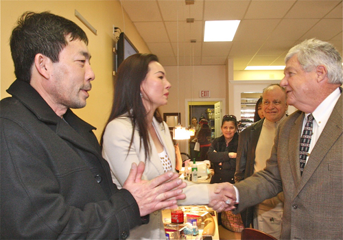 BARBARAELLEN KOCH PHOTO  |  Councilman John Dunleavy welcomes owner Rose Nyugen and her boyfriend Dan Tran to Polish Town Friday afternoon.