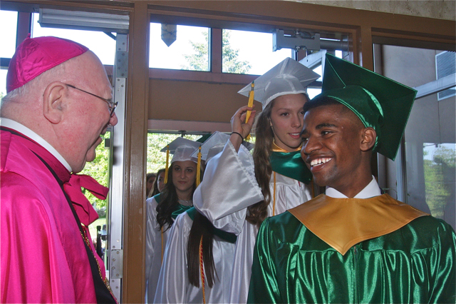 Bereket Watts of Southold flashes a warm smile for Bishop William Murphy. (Credit: Barbaraellen Koch)