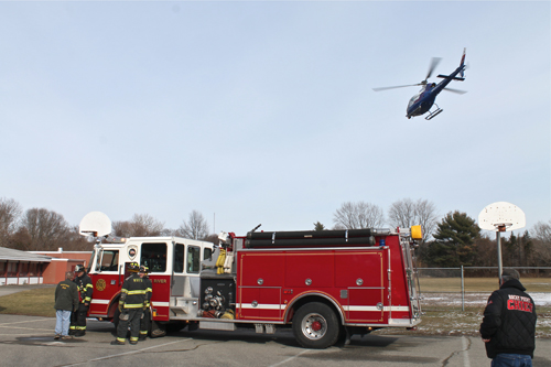 PAUL SQUIRE PHOTO | A Suffolk County police helicopter airlifts a crash victim from Miller Avenue Elementary School
