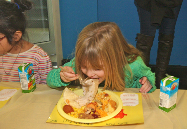 Students enjoy the feast. (Credit: Barbaraellen Koch)