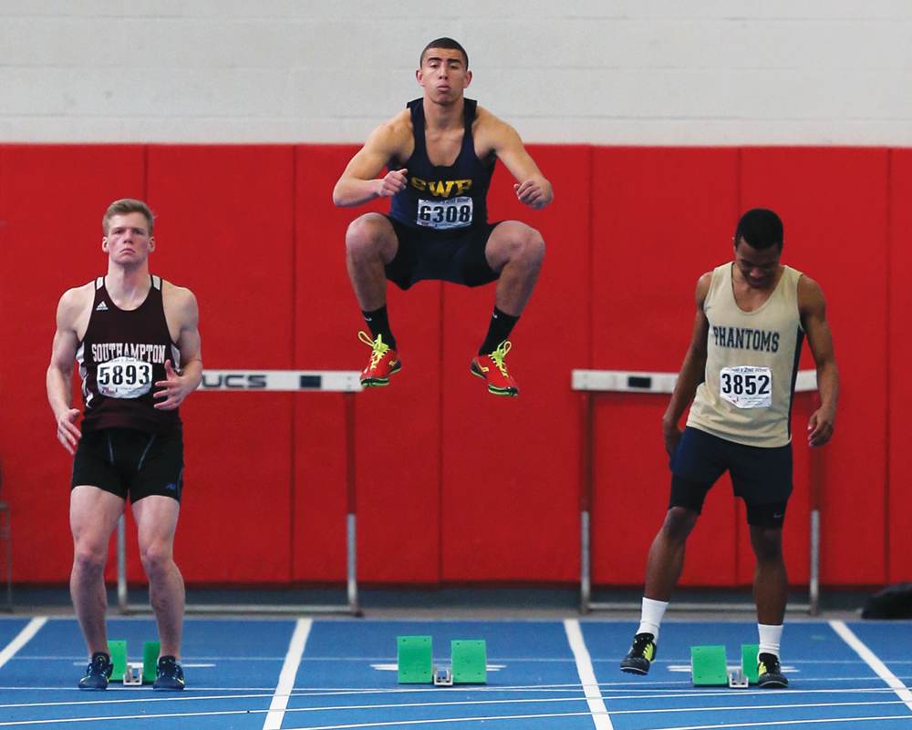 Bryce Casey of Shoreham-Wading Rivern (Center) prepares for the finals in the 55 Meter Dash.  The League V Boys Winter Track Championships were held at Suffolk County Community College Brentwood campus on Jan 25th, 2015Daniel De Mato