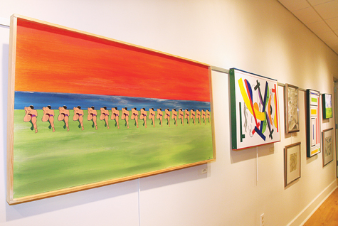 Work by Salvatore Gentile ('The Swimming Lesson' in foreground) is on view at Riverhead Free Library's Elizabeth Fox Overton gallery.