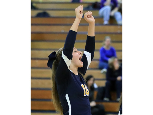 Courtney Wrigley #16 celebrates a point with her teammates during the second set of Shoreham Wading River's three set loss to Sayville at Shoreham Wading River High School in Shoreham on Oct. 27, 2016.