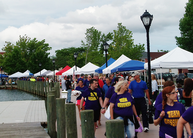 Walkers along the Peconic Riverfront Saturday morning at the third annual Alzheimer's Walk in Riverhead. (Credit: Joe Werkmeister)