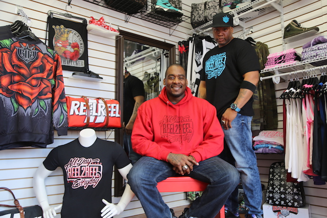 Photo caption:Shawn Diming (left) and Rashad Lawson opened their showroom for Reel2Reel last month on Griffing Avenue in Riverhead. They sell hand-designed clothing, backpacks and other apparel items. (Rachel Siford)