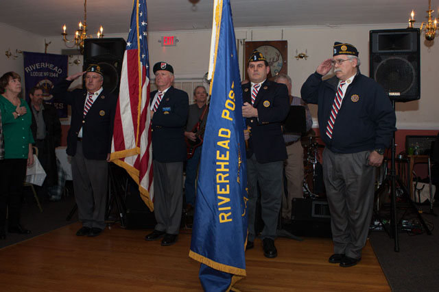 The Riverhead American Legion Color Guard opens the event with the presentation of the colors