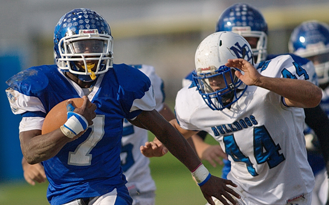 Riverhead running back Ryun Moore leads the Blue Waves' rushing attack this season. (Credit: Garret Meade, file)